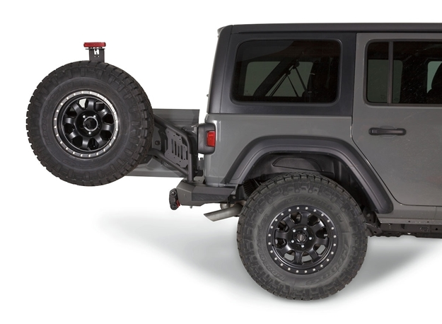 Elite Rear Tire Carrier - 102255 | WARN Industries | White Jeep Sahara Lifted With Tire Carrier And Led Tail Lights |  | WARN Industries