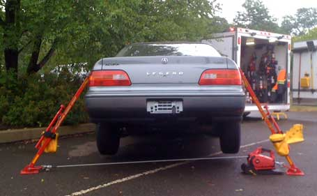 WARN PullzAll lifting a car using Junkyard Dog Industries' struts